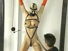Punishment of Blonde Slave Restrained in Harness and Ropes